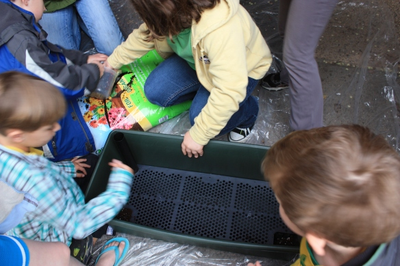 kids gardening in EarthBox self watering container